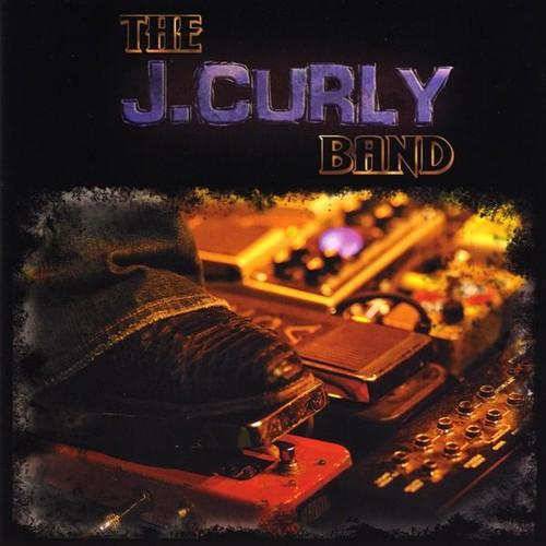 Curly, J.